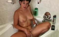 He catches the mature woman masturbating in the bathroom